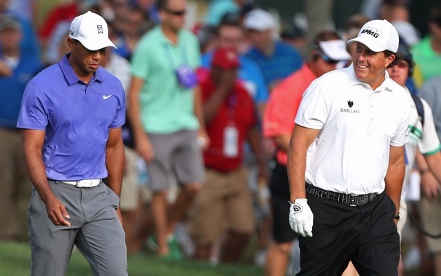 Tiger Woods and Phil Mickelson talk as they walk up the first fairway together during the first round of the 2014 PGA Championship golf tournament at Valhalla Golf Club. Mandatory Credit: Brian Spurlock-USA TODAY Sports