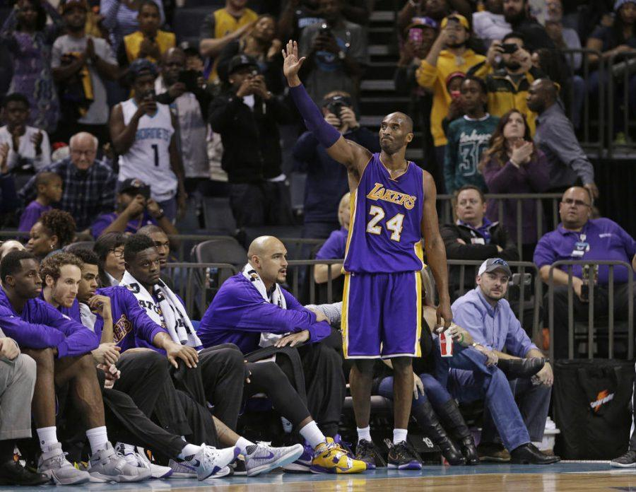 Los Angeles Lakers' Kobe Bryant (24) waves to the crowd as he leaves the game in the second half of an NBA basketball game against the Charlotte Hornets in Charlotte, N.C., Monday, Dec. 28, 2015. The Hornets won 108-98. (AP Photo/Chuck Burton)