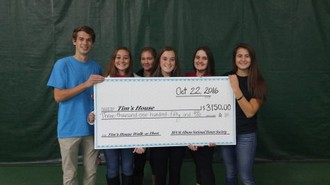 NHS officers with donation check