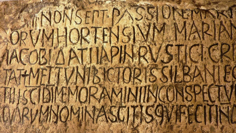 Latin scripture carved on stone   Photo credit: pxfuel.com