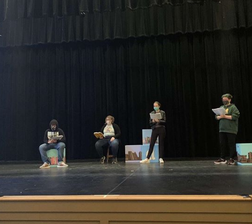 BFA actors rehearsing on stage. Pictured from left to right: Aiden Parah ('24), Emily Parent ('22), Madison Gagner ('23), Katie Galuszka ('23) Photo credit:  Yuki Benjamin