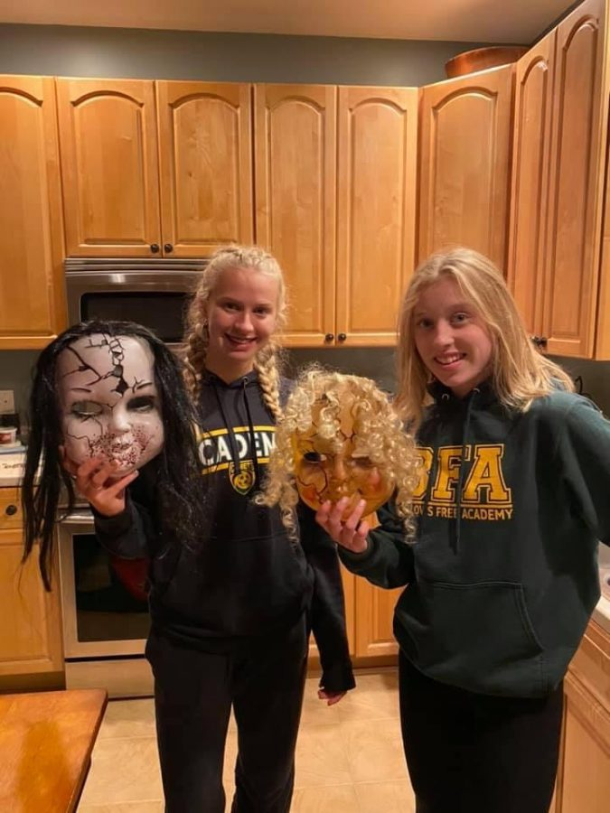The two students From left, Amber Poquette ('24) and Cora Thomas ('24) with the masks they used to fright visitors at Fairfield's Halloween event.