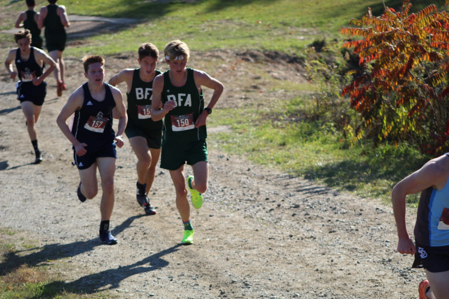 Ethan Mashtare ('22 right) and Calvin Storms ('22 center) racing at Champlain Valley Union High School earlier this season. Both runners finished in the top 10 of the division-one boys' race, the first time BFA has done so (in at least 40 years), according to coach Michael Mashtare. Photo Credit: Michael Mashtare