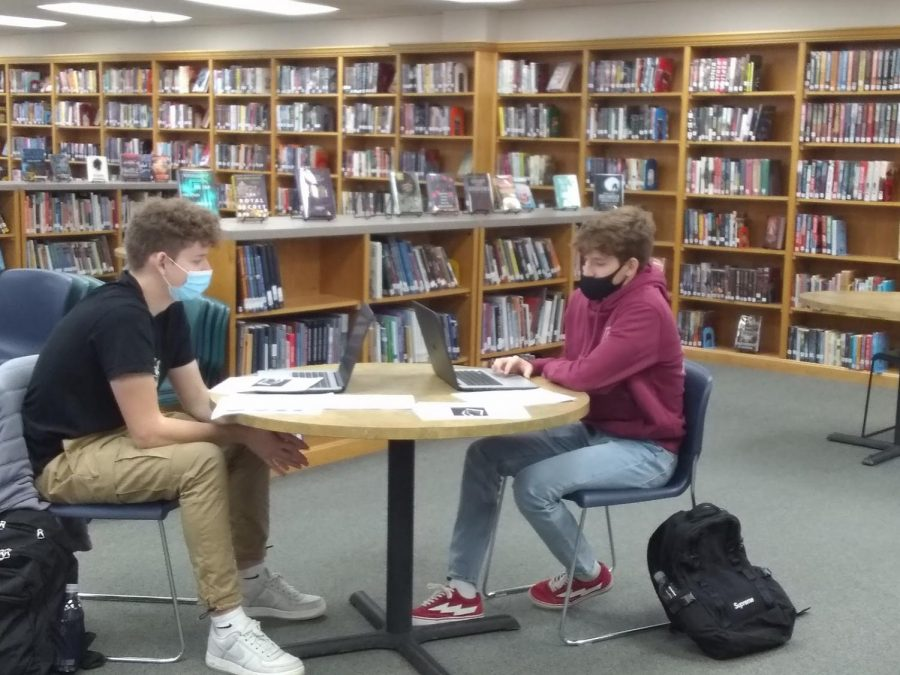 Colin Jolley ('21) and Peter Jolley ('21)  tediously fill out the Common Application.  Photo Credit: Alisa Aylward