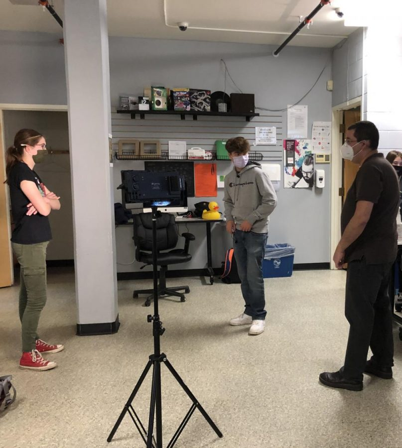 Steven Davis works with Megan Jamison ('23) and Trey Desautels ('23) in his Digital Media class.  Photo Credit: Isabella Bonasera