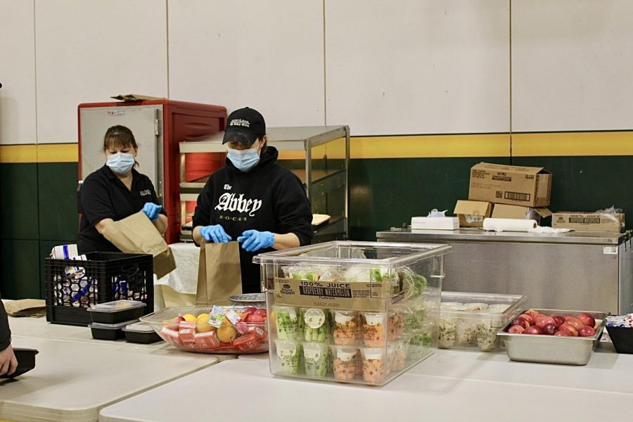 Site manager Jen Bombardier (left) works to prepare meals for BFA students. Photo credit: Helen Simmons