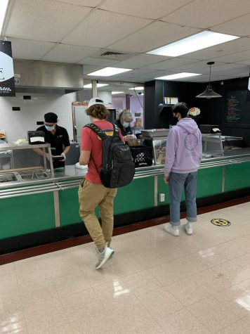 BFA students social distance while waiting to receive their packaged lunches. Photo credit: Thomas Remillard (