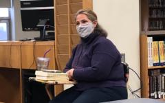 Polly Rico facilitates her Book Club. Photo credit:  Adelyne Collin