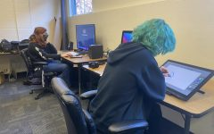 Students working on the Multimedia Club projects.  Photo credit: Flavie Lamat