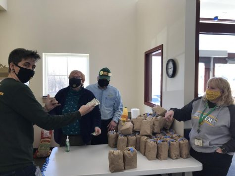 From left: BFA math teacher Nicole Schubert purchases popcorn from Ellen and Bob Gissel. Karla Kane (far right) helped co-organize the event.  Photo credit:  Rachel Ledoux