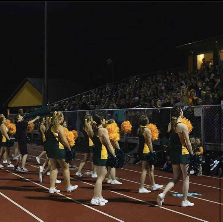 Bellows Free Academy cheerleaders get the fans excited at a BFA football game. Photo credit: Adelyne Collin