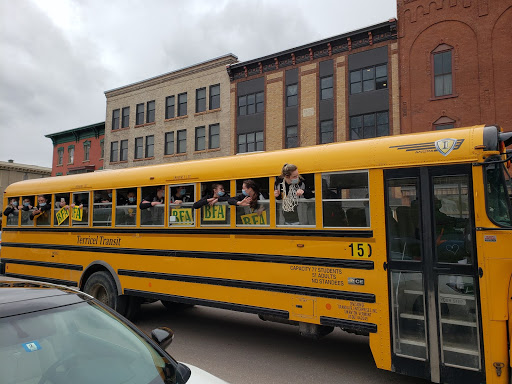 The Comets celebrate their big win with a ride down Main Street.  Photo credit:  Heather Dunigan