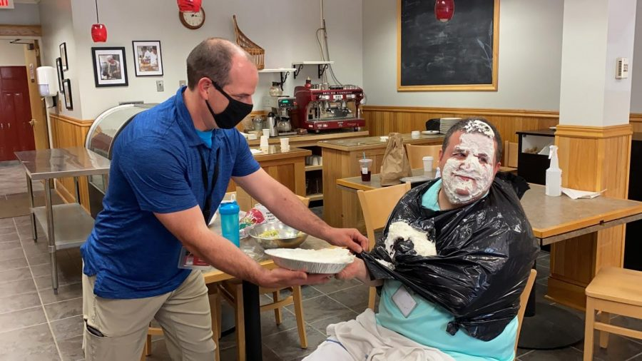 Kieran Kivlehan receives his pie in the face from NCTC teacher Tim Hurteau.  Photo credit:  Lindsay Bernard (22)