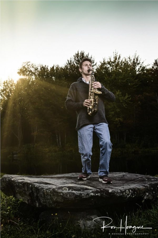 Nathaniel Cobb (21) plays the sax.  Photo credit:  Ron Hoague