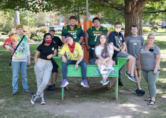 NCTC students and staff celebrate the end of their community scavenger hunt at Taylor Park. Photo credit:  Dino Patsouris