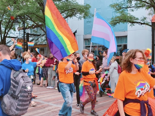 People marching down Church St., Burlington Vt. during the pride parade.  Photo: Jasmine Duncan (23)