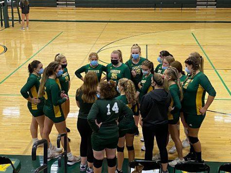 Coach Lauren Liberatore talking to the Junior Varsity girls' volleyball team.  Photo Credit: Jennifer Parent